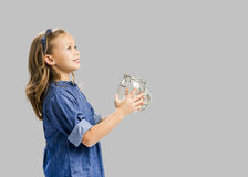 My magic pot. Cute girl holding a glass pot and release something Stock Photography