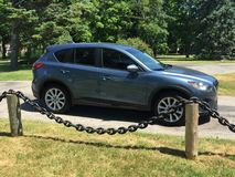 My Mazda CX-5 looking for scenic views in Goderich Ontario Canada. My zoom zoom being used to hunt for scenic views in Goderich Ontario Canada in a peaceful park stock photos
