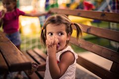My moment for desert. Little girl sitting and eating ice cream. Space for copy. Close up stock image