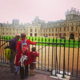 Family on vacation in London in front of Windsor Castle Stock Photo