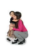 My Mommy. A small girl clings to her mother not wanting her to leave. A mother trying to console her child. Often how children feel with working mothers Royalty Free Stock Image