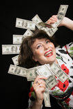 My Money. Woman with hand of money, looking Ecstatic with herself on a Black background Stock Images