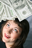 My Money. Woman with hand of money, look up with herself on a Black background Stock Photos