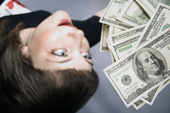 My Money. Woman with hand of money, looking Ecstatic Stock Photos