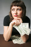 My Money. Woman with hand of money, looking sadness with herself Royalty Free Stock Photos