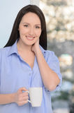 My morning starts with coffee. Beautiful middle-aged woman stand Royalty Free Stock Photo