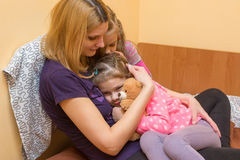 My mother and older sister comforted little girl Stock Images