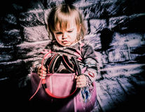 My music. Little girl 1-2 years old listening her big headphones Stock Photos