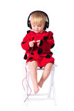My music. Little girl 1-2 years old. Listening To Her Headphones Stock Photo