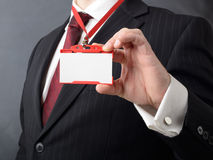 My name is. Man in suit showing id or name badge Royalty Free Stock Photo
