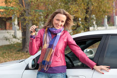 This is my new car!. Happy girl shows the key of her new car Royalty Free Stock Images