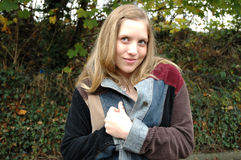 My new coat. Stunning young woman in her autumn coat royalty free stock image