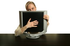 My new computer. Blond woman hugging her new monitor Royalty Free Stock Photography