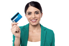 My new gold credit card !. Female executive showing her new credit card Stock Photography
