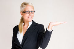 My offer. My offer, portrait of a beautiful young blond business woman holding out the palm of her hand Stock Images