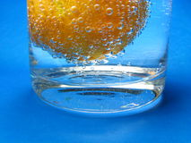 It is my oxygen bath  2. Mandarin floating in a glass with mineral water Royalty Free Stock Photos