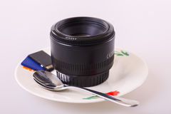 My passion. A lens rather than a cup of coffee Stock Photos