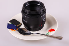 My passion. A lens rather than a cup of coffee Royalty Free Stock Images