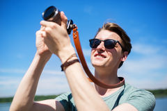 This is my passion. A photo of young photographer taking a picture against the sun Royalty Free Stock Images