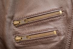 A brown premium leather jacket with two pocket zips closed. This is my persona leather jacket. This jacket is as soft as it can get yet it is strong enough to Stock Photography