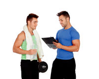 With my personal trainer. Isolated on a white background Royalty Free Stock Photography