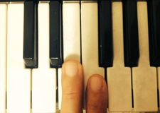My piano keys. Me using my piano royalty free stock photo