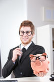 My piggybank and me: a really nice couple, aren't we? Stock Images