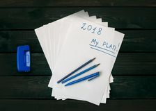 My plan 2018. White paper for notes, pencils, blue, pen, hole punch, and the inscription`My plan 2018 Stock Photography
