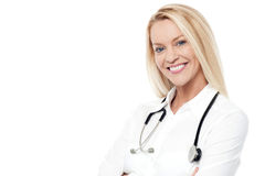 My pleasure to serve you !. Confident female doctor posing with warm smile Royalty Free Stock Photo