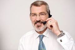 My pleasure to serve you. Experienced call center agent with headset Royalty Free Stock Images