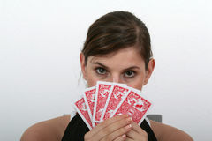My Poker Cards. A young beautiful woman is holding her poker cards Royalty Free Stock Photos