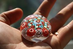 MY Precious. Colour glass in a hand Royalty Free Stock Image