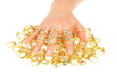 My precious. A woman's hand wearing a lot of golden rings covering a bulk of rings Royalty Free Stock Image