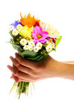My present for you. Hand holding bunch of various flowers Stock Photo