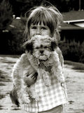 My puppy. A young girl holding her cute fluffy puppy royalty free stock photography