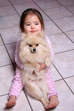 My Puppy. Child sitting with her dog royalty free stock photos