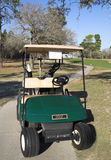 My Ride. Golf cart on path in Florida in February royalty free stock photography