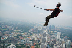 My selfie on the sky. KUALA LUMPUR, MALAYSIA - SEPTEMBER 27: A BASE jumpers in jumps off from KL Tower at September 27, 2014. Their are an experienced BASE Royalty Free Stock Photos