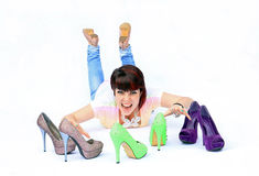 My shoes. A young woman shouts with joy at her new shoes Stock Photo