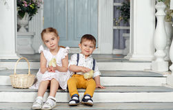 My sister and younger brother sitting on the stairs at home and Royalty Free Stock Photos