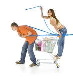 My slave. Young couple with trolley. Boy is pulling full troley with girl. Girl is looking at camera and smiling. White background, side view. Whole body Royalty Free Stock Photography