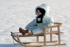 On my sled. A baby sitting on sled Royalty Free Stock Photo