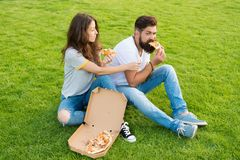 This is my slice. summer picnic on green grass. happy couple eating pizza. family weekend. couple in love dating. fast. Food. bearded men hipster and adorable royalty free stock photo