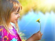 My spring. Little girl holding dandelion flower Royalty Free Stock Photos