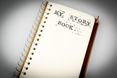 My story book on the white with brown pencil. My story book on the white, Diary with text and pencil Royalty Free Stock Photo