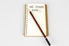 My story book on the white with brown pencil. My story book on the white, Diary with text and pencil Royalty Free Stock Images