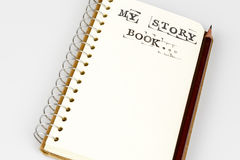 My story book on the white with brown pencil. My story book on the white, Diary with text and pencil Stock Photography