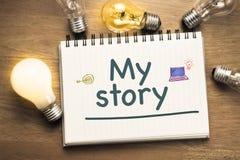My Story Idea. My Story text on notebook with light bulbs Royalty Free Stock Photos