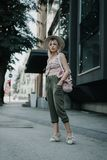 That is my street style. Beautiful young stylish fashion model i. N the streets in a sunny day. Beautiful woman having a sunny day in Sarajevo Stock Photos