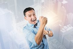 Joyful nice man being happy. My success. Joyful nice handsome man looking at you and smiling while feeling happy about his success Royalty Free Stock Photography